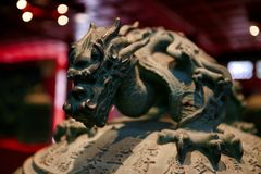 The decor element is the handle of a bell in the form of a dragon. Big Bell Temple. Beijing, China royalty free stock photo