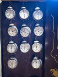 Museum of the clock. Prague, Czech Republic. a large number of alarms behind the glass in the display case.  stock photo