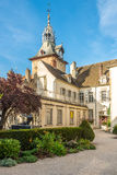 Museum of Dali with Clock Tower in Beaune Stock Images