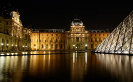 Museum du Louvre and the Pyramid at night Royalty Free Stock Photography
