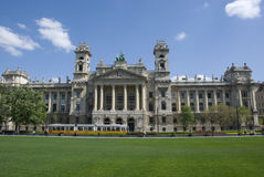 Museum for Ethnology, Budapest. Budapest, Hungary - April 27, 2014: Exterior view of Budapest's Museum for Ethnology in Budapest, wih an old tram passing in Royalty Free Stock Image