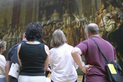 Museum goers viewing The Coronation of Napoleon by Jacques-Louis David, 1808 at the Louvre Museum, Paris, France Royalty Free Stock Photos