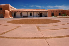 Museum Hill, Santa Fe. A traditional adobe building located on Museum Hill in Santa Fe, New Mexico. Front plaza area shows unusual paving detail Royalty Free Stock Photography