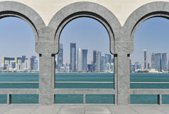 Museum Of Islamic Art, Doha, Qatar. Through the arches towards the Doha skyline at The Museum Of Islamic Art, Doha Royalty Free Stock Photography
