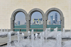 Museum Of Islamic Art, Doha, Qatar. The Museum Of Islamic Art, Doha, Qatar with fountain and arches and Doha skyline in the distance Royalty Free Stock Image