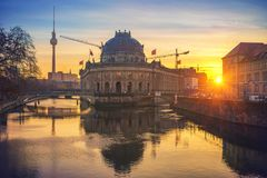 Museum Island on Spree river at sunrise, Berlin. Museum Island on Spree river and TV tower in the background at sunrise, Berlin, Germany Royalty Free Stock Photo