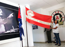 Museum of Literacy in Cuba. Luisa Yara Campos, Cuban literacy museum director gives a lecture on Cuban National Literacy Campaign. She holds a flag that says in Royalty Free Stock Photo