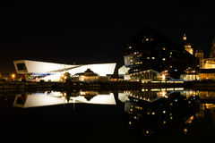 Museum of Liverpool at night. A long exposure shot of Museum of Liverpool at night with reflections on water Royalty Free Stock Photography