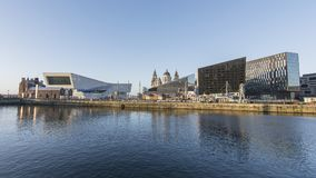 Liverpool Albert Dock - Waterfront. Museum of Liverpool and other modern buildings sit on the front of the dock. In the background are the historic Liver royalty free stock photos