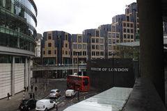 Museum of London, red buss, England, urban street scene with modern architecture Stock Images
