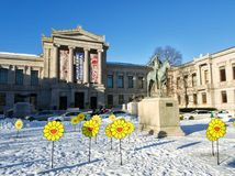 Museum of Fine Arts in Boston with Appeal to the Great Spirit statue and some Tsuji Murakami flowers in a view. Museum of Modern Arts in Boston, MA, USA with royalty free stock photos