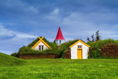 The museum of pioneers - Vikings. The village of ancestors in Iceland. The recreated village -  museum of pioneers - Vikings. Houses are roofed by the turf Stock Photography