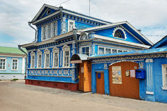 The Museum of of samovars, old blue wooden house with carved patterns stock photo