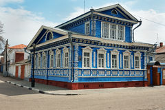 The Museum of of samovars, old blue wooden house with carved patterns royalty free stock image