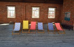 Deck chairs at Manchester Museum of Science and Industry. Museum of Science and Industry Liverpool Road exterior shot of coloured deckchairs on the former stock images