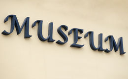 Museum sign on a building in Brasov Stock Photos