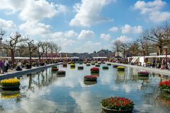 Museum Square in Amsterdam with floating tulips visited by many tourists Royalty Free Stock Photos