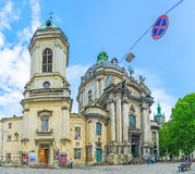 The Museum square in Lvov. LVOV, UKRAINE - MAY 16, 2017: Panorama of the former Dominican church, nowadays Holy Eucharist Greek Catholic church, located in royalty free stock photos
