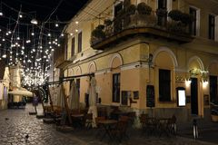 Museum Square by night in Cluj-Napoca, Transylvania, Romania royalty free stock photo