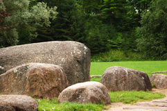 Museum of stones in Lithuania. Park with trees and big stones stock images