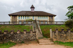 Museum at traditional palace of the Fon of Bafut with brick and tile buildings and jungle environment, Cameroon, Africa.  royalty free stock photography