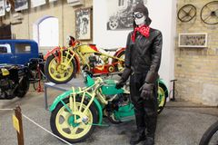 Museum of transport - historical bicycle and a figurine in vintage clothes representing a biker stock photo