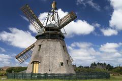 Museum windmill in a cloudy sky royalty free stock photos