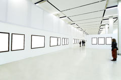 museumfolksilhouettes arkivfoton