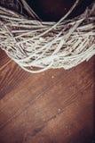 Musgo y guirnaldas de madera Fotografía de archivo