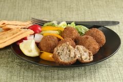 Mushroom arancini. Delicious mushroom and mozarella arancini wit salad Stock Photos
