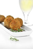 Mushroom Arancini. Italian appetizer Mushroom Arancini with mozzarella cheese filling coated in breadcrumbs with thyme herbs. Generous accommodation for copy Royalty Free Stock Photos