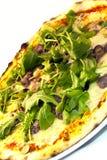 Mushroom and arugula pizza Stock Images