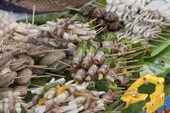 Mushroom and bacon stick. Koh Phangan's walking street market, street food Stock Photos