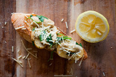 Mushroom baguette with lemon slice. Stock Images