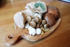 Mushroom on Brown Wooden Plate Stock Photo