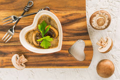 Mushroom casserole on wooden board Royalty Free Stock Photos