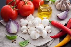 Mushroom champignon with italian ingredients Royalty Free Stock Photography