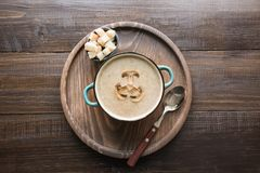 Mushroom champignon cream soup on dark wooden board. View from above. Delicious mushroom champignon cream soup on dark wooden board. Top view. Horizontal royalty free stock images