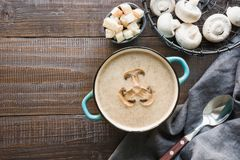 Mushroom champignon cream soup on dark wooden board. View from above. Space for text. Delicious mushroom champignon cream soup on dark wooden board. Top view stock photo