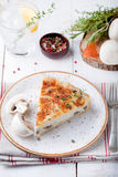 Mushroom, champignon pie, quiche slice on a ceramic plate Stock Photo