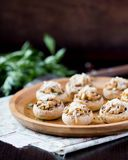 Mushroom champignons stuffed with filling of chicken, cheese Royalty Free Stock Image