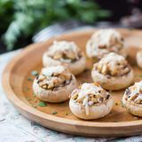 Mushroom champignons stuffed with filling of chicken, cheese Stock Image