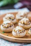 Mushroom champignons stuffed with filling of chicken, cheese Stock Images