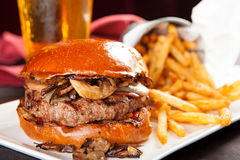 Mushroom and Cheese Hamburger With French Fries Stock Photography