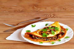 Mushroom, cheese and herb omelet recipe Royalty Free Stock Images