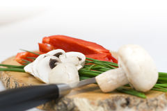 Mushroom with chive on a cutting board Stock Photos