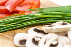 Mushroom with chives and red pepper Stock Images