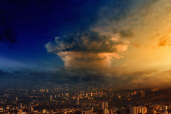 Mushroom cloud. Look like nuclear bomb explosion over big town Stock Images