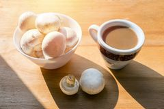 Mushroom Coffee Superfood Trend. Cup of coffee and white bowl wi stock image