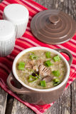 Mushroom cream soup in a bowl. Close-up vertical Royalty Free Stock Images